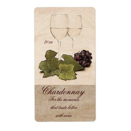 white wine glasses with grapes wine label