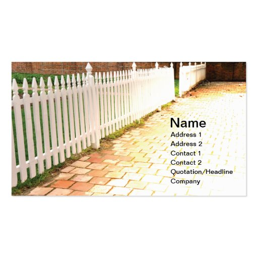 white wood picket fence by brick walkway business cards