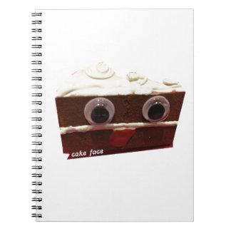 whitey chocolate cake face with logo note books