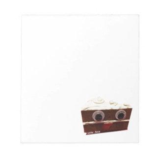 whitey chocolate cake face with logo notepad