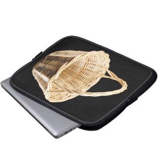 Wicker basket on black background laptop sleeve