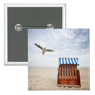 Wicker beach chair on beach pin