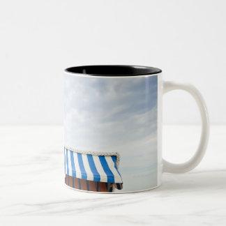 Wicker beach chair on beach Two-Tone coffee mug