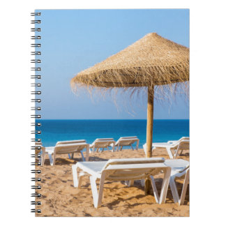 Wicker parasol with beach beds.JPG Notebooks
