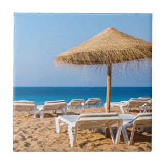 Wicker parasol with beach beds.JPG Tile