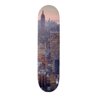 Wide view of Manhattan at sunset Skate Boards