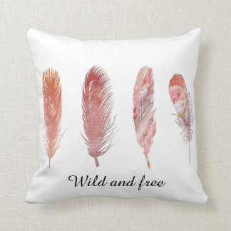 Wild and free pink and peach feathers on white cushion
