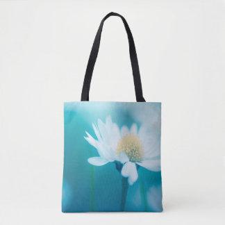 Wild flower in blue tote bag
