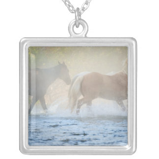 Wild horses running through water silver plated necklace
