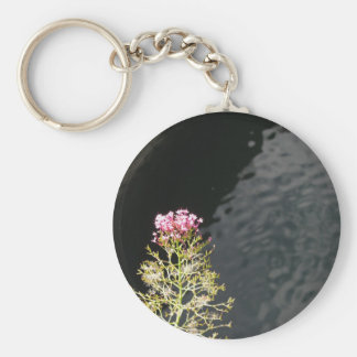 Wildflowers against the water surface of a river key ring