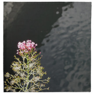 Wildflowers against the water surface of a river napkin