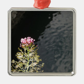 Wildflowers against the water surface of a river Silver-Colored square decoration