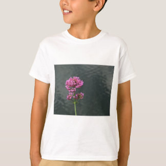 Wildflowers against the water surface of a river T-Shirt