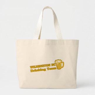 Wilson Drinking Team tee shirts Tote Bags