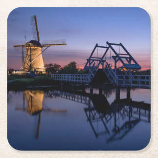 Windmills and a drawbridge at sunset coaster