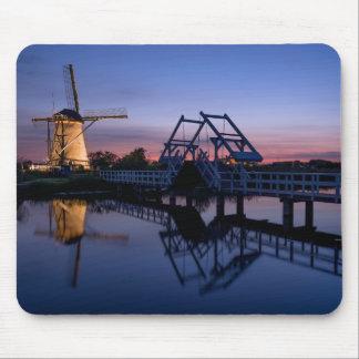 Windmills and a drawbridge at sunset mousepad