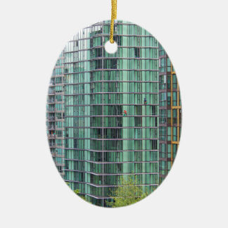 Window washers on downtown high rise building ceramic ornament
