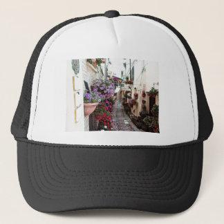 Windows, balcony and flower alleys in Spello Trucker Hat