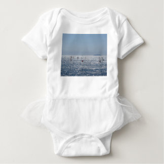 Windsurfing in the sea . Windsurfers silhouettes Baby Bodysuit