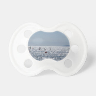 Windsurfing in the sea . Windsurfers silhouettes Baby Pacifiers