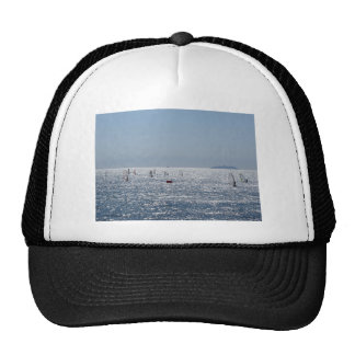Windsurfing in the sea . Windsurfers silhouettes Cap