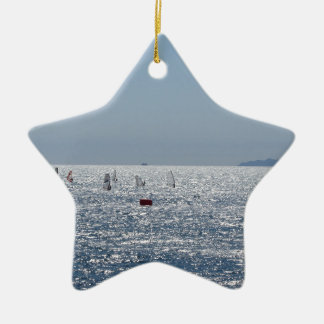 Windsurfing in the sea . Windsurfers silhouettes Ceramic Ornament