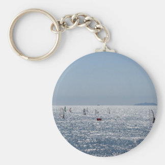 Windsurfing in the sea . Windsurfers silhouettes Key Ring
