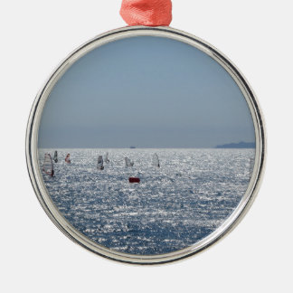 Windsurfing in the sea . Windsurfers silhouettes Metal Ornament