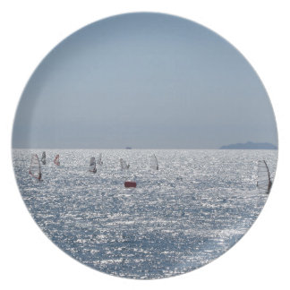 Windsurfing in the sea . Windsurfers silhouettes Plate
