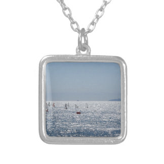 Windsurfing in the sea . Windsurfers silhouettes Silver Plated Necklace