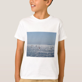 Windsurfing in the sea . Windsurfers silhouettes T-Shirt