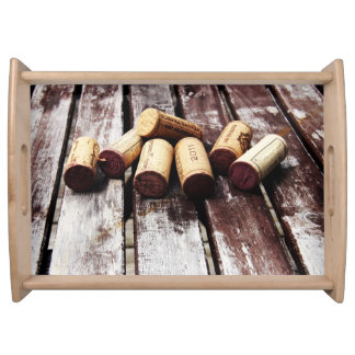 Wine bottle corks on rustic wood texture serving tray