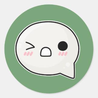 Winking sad face round sticker