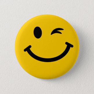 Winking smiley face 6 cm round badge