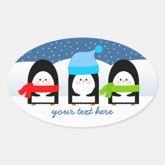 Winter Penguin Trio Snowy Night Oval Sticker