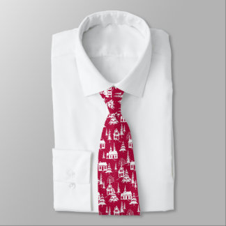 Winter snow-covered village on red background tie