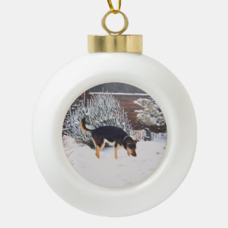 Winter snow scene with cute black and tan dog ceramic ball christmas ornament