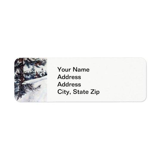 Winter snow with pine tree trunks cold landscape. return address label