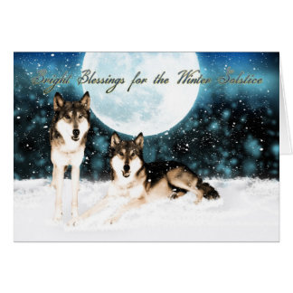 winter solstice greeting card with wolfs and moon