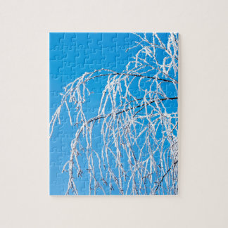 Winter tree branches covered with frost snow jigsaw puzzle