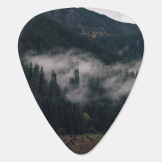 Wispy clouds over a green mountain plectrum