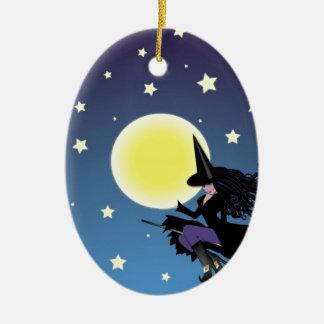 witch on broom ceramic ornament