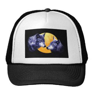 Wolves at full moon cap