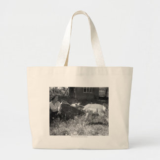 Woman bottle feeding an antelope. large tote bag