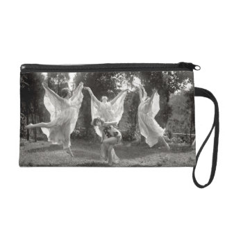 Woman dancing wristlet clutches