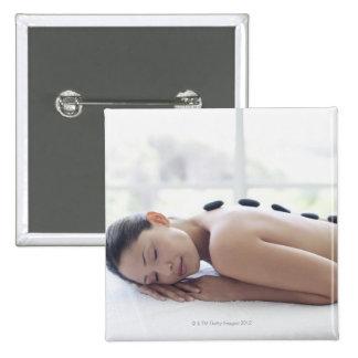 Woman enjoying lastone therapy 15 cm square badge