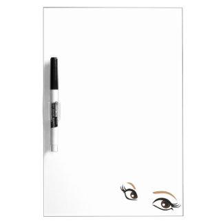 Woman eyes dry erase board