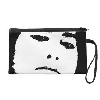 woman face wristlet purses