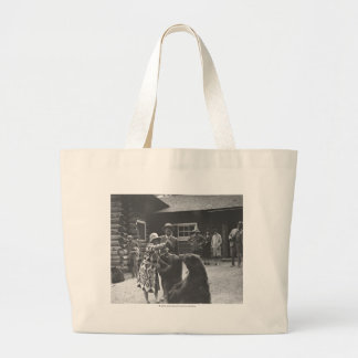 Woman feeding bears. large tote bag