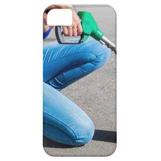 Woman filling yellow can with gasoline or petrol. case for the iPhone 5